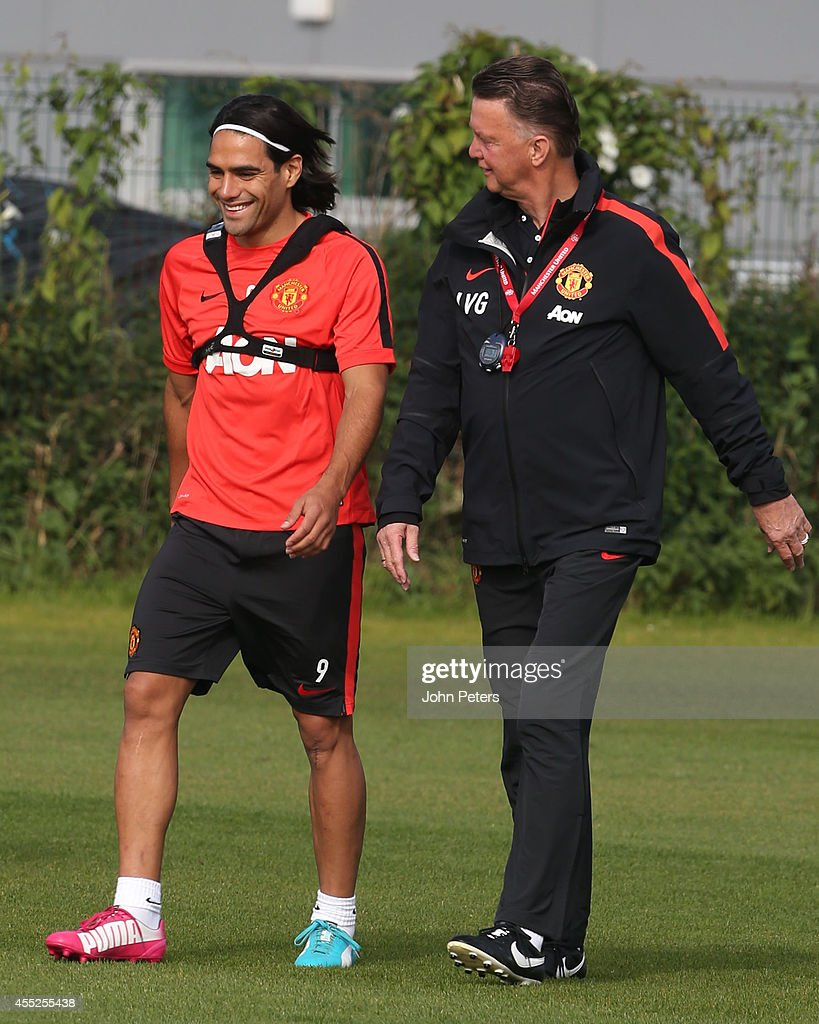 Radomel Falcao and Manager Louis van Gaal of Manchester United in action during a first team training session at Aon Training Complex on September 11, 2014 in Manchester, England.