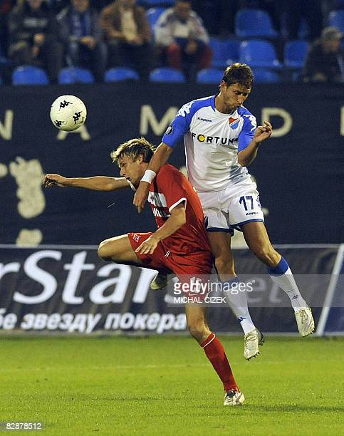 Radoslav Kovac of Spartak Moscow goes for a header with David Strihavka of Banik Ostrava during their first leg of first round UEFA Cup football...