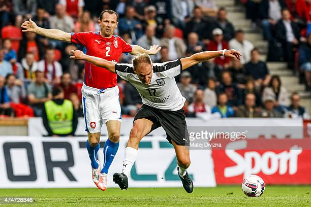 Radoslav Latal of Czech Republic battles for the ball with Alexander Zickler of Germany during legends match between Czech Republic and Germany at...