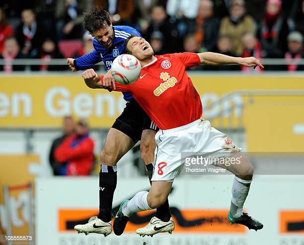 Radoslav Zabavnik of Mainz battles for the ball with Ruud van Nistelrooy of Hamburg during the Bundesliga match between FSV Mainz 05 and Hamburger SV...
