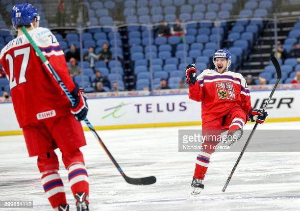 Radovan Pavlík of Czech Republic celebrates the first of his two second period goals with Ostap Safin during the second period of play in the IIHF...