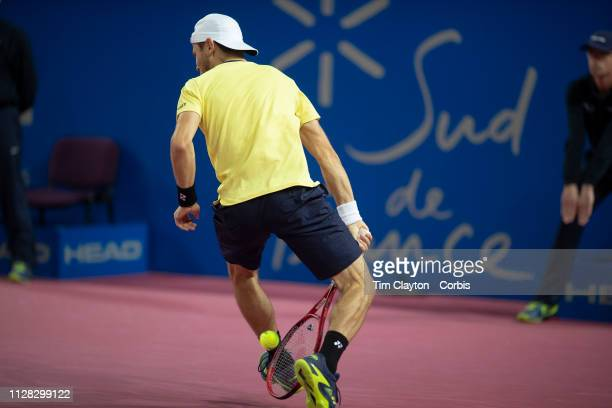 Radu Albot of Moldova plays a shot through his legs during his match against Marcos Baghdatis of Cyprus in the Men's QuarterFinal match during the...