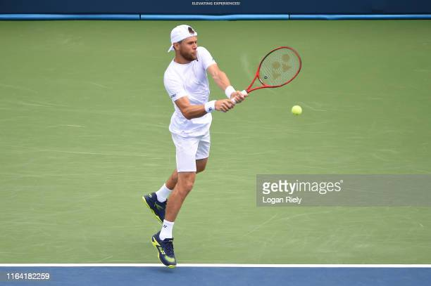 Radu Albot of Moldova returns a backhand to Marcelo Arevalo of El Salvador and Miguel Reyes-Varela of Mexico during the BB&T Atlanta Open at Atlantic...