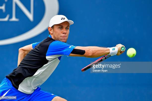 Radu Albot of Moldova returns a shot to Ernesto Escobedo of the United States on Day One of the 2017 US Open at the USTA Billie Jean King National...
