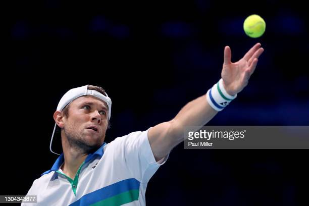Radu Albot of Moldova serves in his Men's Singles Semifinals match against Alexander Bublik of Kazakhstan on day six of the Singapore Tennis Open at...