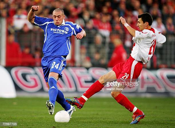 Radu Sergiu of Cottbus and Christian Pander of Schalke compete for the ball during the Bundesliga match between Energie Cottbus and Schalke 04 at the...