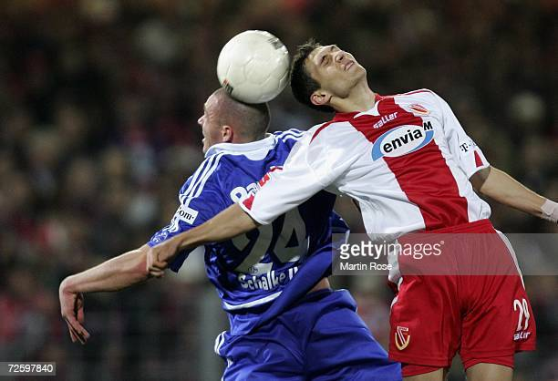 Radu Sergiu of Cottbus and Christian Pander of Schalke head for the ball during the Bundesliga match between Energie Cottbus and Schalke 04 at the...