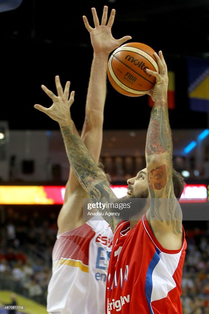 Raduljica (R) of Serbia is in action during the EuroBasket 2015 group B match between Spain and Serbia at Mercedes-Benz Arena in Berlin, Germany on September 5, 2015.