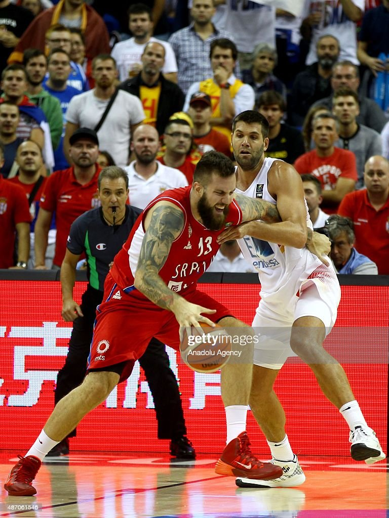Raduljica (13) of Serbia is in action during the EuroBasket 2015 group B match between Spain and Serbia at Mercedes-Benz Arena in Berlin, Germany on September 5, 2015.