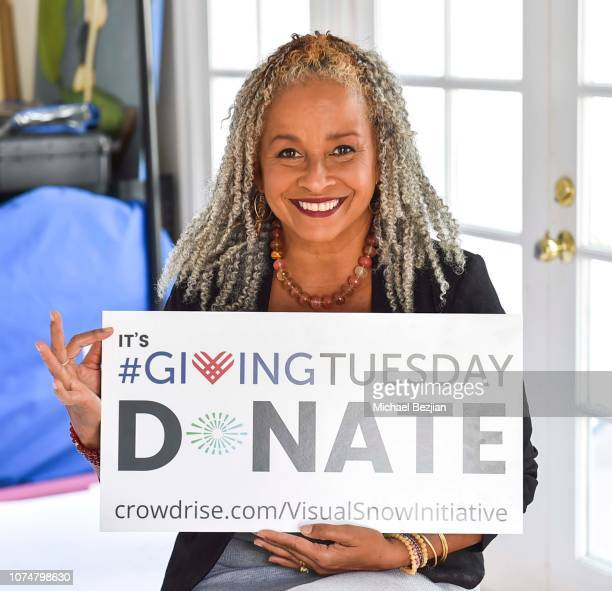 Rae Dawn Chong poses with Visual Snow Initiative at Visual Snow Initiative Celebrates GIVINGTUESDAY At The Artists Project on November 27 2018 in Los...