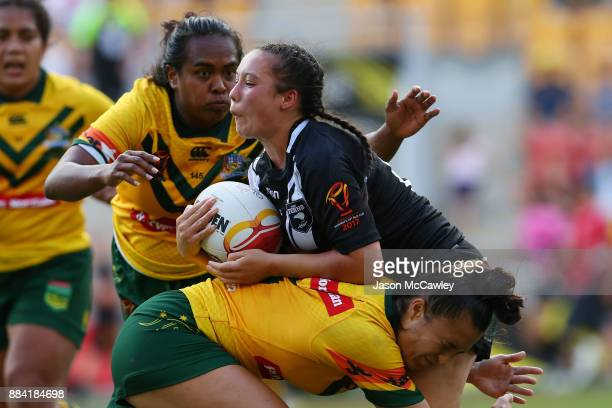 Raecene McGregor of the Ferns is tackled during the 2017 Rugby League Women's World Cup Final between Australia and New Zealand at Suncorp Stadium on...