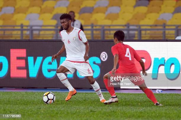 Raed Ibrahim Saleh of Oman in action with Muhammad Nazrul of Singapore during the Airmarine Cup final between Singapore and Oman at Bukit Jalil...