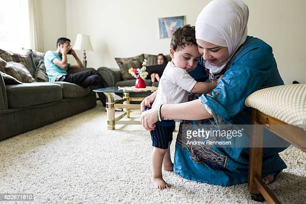Raeda gets Taym ready to play outside on July 28 2015 in Bloomfield Hills Michigan Since the war started the United States has resettled under 1500...
