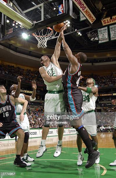 Raef LaFrentz of the Boston Celtics blocks Lorenzen Wright of the Memphis Grizzlies during the game at the Fleetcenter on December 1 2003 in Boston...
