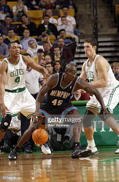 Raef LaFrentz of the Boston Celtics defends against Bo Outlaw of the Memphis Grizzlies during the game at the Fleetcenter on December 1 2003 in...
