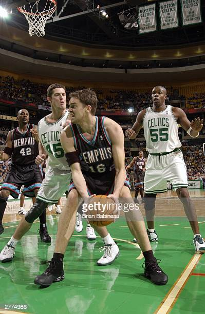 Raef LaFrentz of the Boston Celtics defends against Pau Gasol of the Memphis Grizzlies during the game at the Fleetcenter on December 1 2003 in...