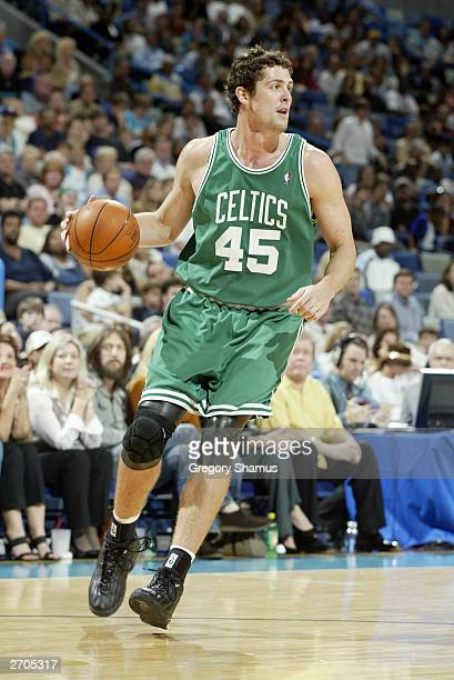 Raef LaFrentz of the Boston Celtics drives against the New Orleans Hornets during the game at New Orleans Arena on November 1 2003 in New Orleans...