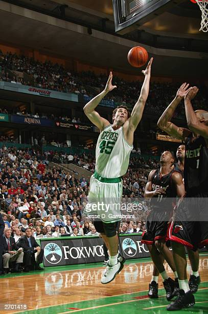 Raef LaFrentz of the Boston Celtics lays a shot up during the game against the Miami Heat at FleetCenter on October 29 2003 in Boston Massachusetts...