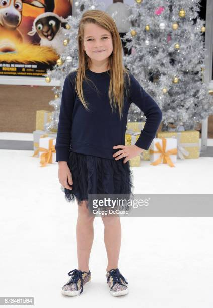 Raegan Revord arrives at the premiere of Columbia Pictures' The Star at Regency Village Theatre on November 12 2017 in Westwood California