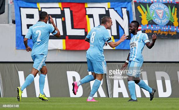 Raegy Ofosu of Chemnitz jubilates with team mates after scoring the first goal during the third league match between Chemnitzer FC and Holstein Kiel...