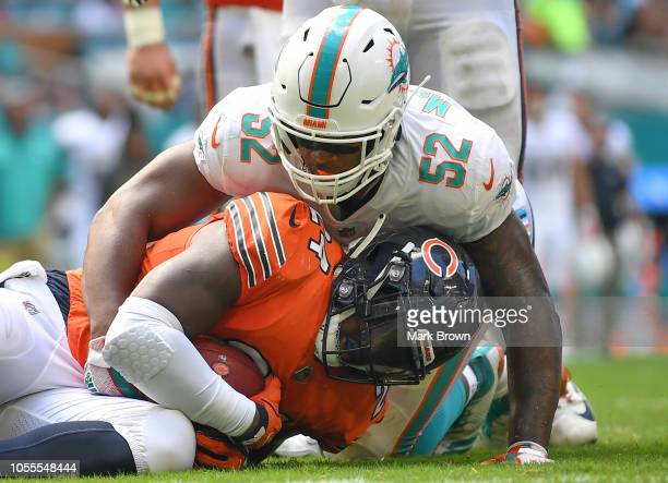 Raekwon McMillan of the Miami Dolphins in action against the Chicago Bears at Hard Rock Stadium on October 14 2018 in Miami Florida