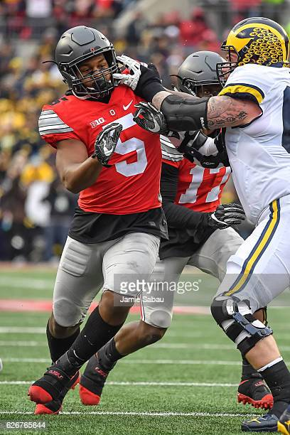 Raekwon McMillan of the Ohio State Buckeyes chases after the ballcarrier against the Michigan Wolverines at Ohio Stadium on November 26 2016 in...