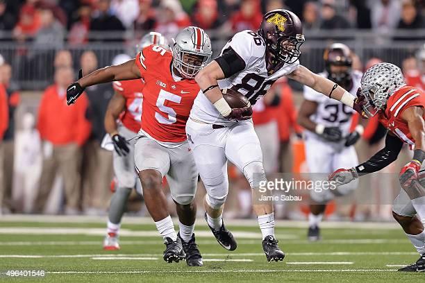 Raekwon McMillan of the Ohio State Buckeyes chases down Brandon Lingen of the Minnesota Golden Gophers at Ohio Stadium on November 7 2015 in Columbus...
