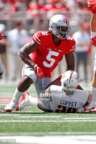 Raekwon McMillan of the Ohio State Buckeyes stands up after tackling Fred Coppet of the Bowling Green Falcons during the game on September 3 2016 at...