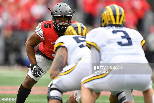 Raekwon McMillan of the Ohio State Buckeyes waits for the play to begin against the Michigan Wolverines at Ohio Stadium on November 26 2016 in...