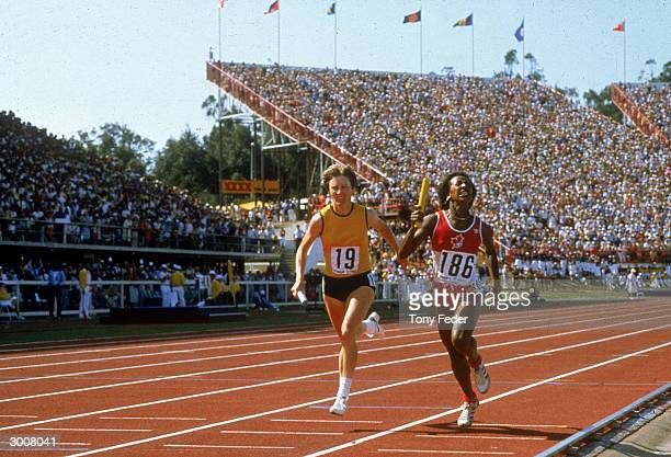 Raelene Boyle of Australia and Angela Bailey of Canada in action in the Womens Relay during the 1982 Commonwealth Games held in Brisbane Australia