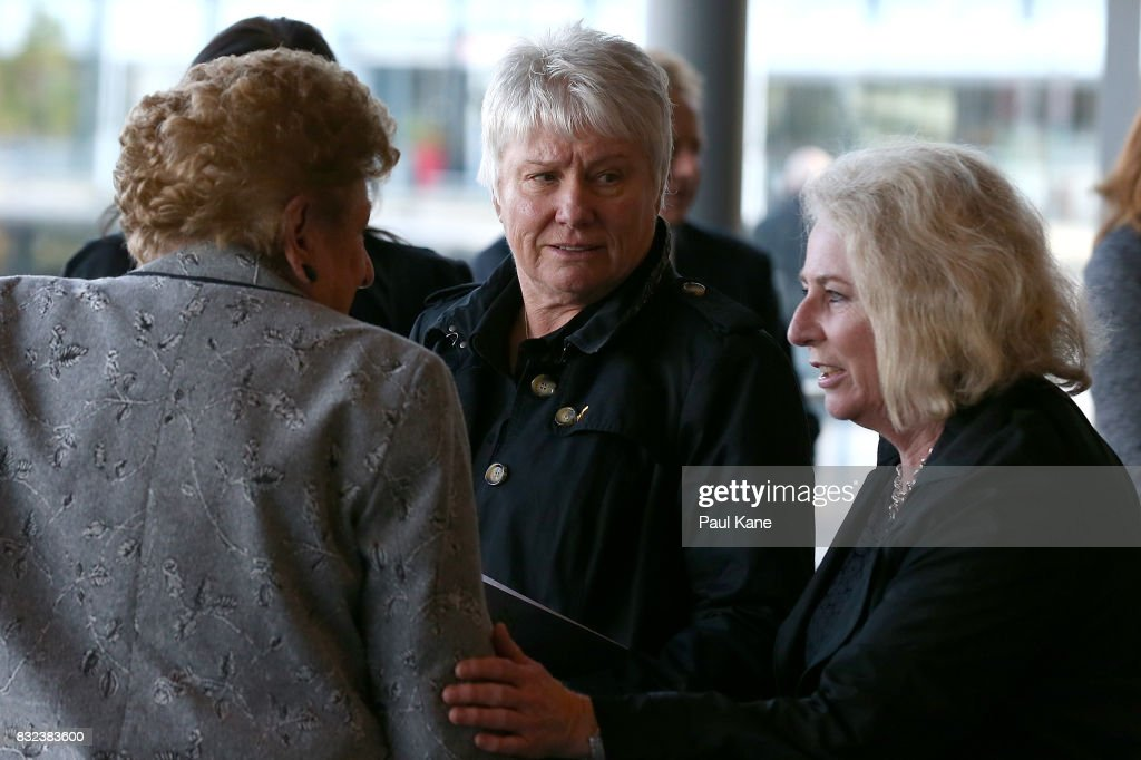 Raelene Boyle talks with other mourners following the funeral service for Betty Cuthbert at Mandurah Performing Arts Centre on August 16, 2017 in Mandurah, Australia. Betty Cuthbert was known as 'The Golden Girl' at the 1956 Melbourne Olympics, winning the 100m, 200m and 4x100m relay. After sustaining an injury at the Rome Olympics in 1960, Cuthbert came out of a short-lived retirement to win her fourth Olympic gold medal in the 400m at the 1964 Tokyo Olympic Games. Betty Cuthbert passed away on 6 August 2017, aged 79.