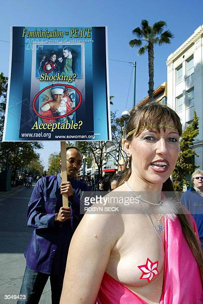 Raelian believer Debbie Weaver of Los Angeles bare her breast as she marches with other Raelians as they march in Santa Monica California 06 March...