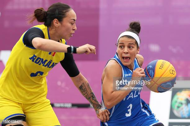 Raelin D Alie of Team Italy is challenged by Sonia Ursu of Team Romania during the Women's Pool Round match between Romania and Italy on day two of...