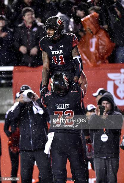 Raelon Singleton and Garett Bolles of the Utah Utes celebrate Singleton's fourth quarter touchdown against the USC Trojans at Rice-Eccles Stadium on...