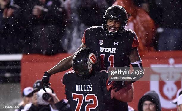 Raelon Singleton and Garett Bolles of the Utah Utes celebrate Singleton's fourth quarter touchdown against the USC Trojans at RiceEccles Stadium on...