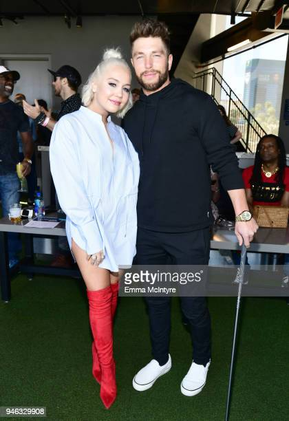 RaeLynn and Chris Lane attend the ACM Lifting Lives TOPGOLF TeeOff at Topgolf Las Vegas on April 14 2018 in Las Vegas Nevada