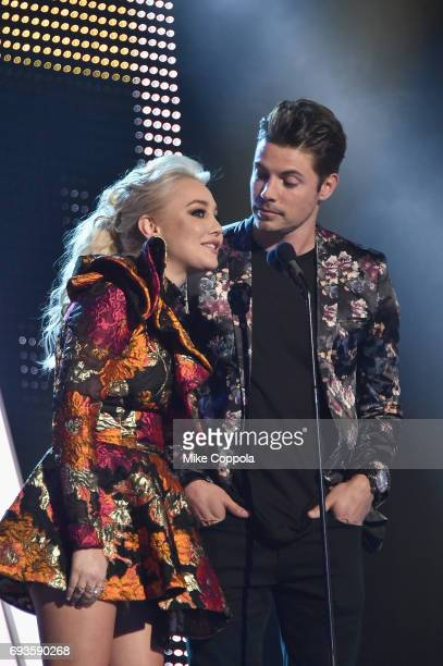 RaeLynn and Josh Henderson speak onstage during the 2017 CMT Music Awards at the Music City Center on June 6 2017 in Nashville Tennessee