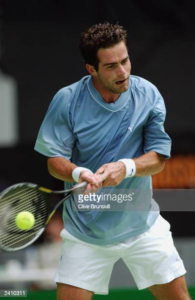 Raemon Sluiter of The Netherlands exhibits his forehand against Marat Safin of Russia during the Australian Open Tennis Championships at Melbourne...