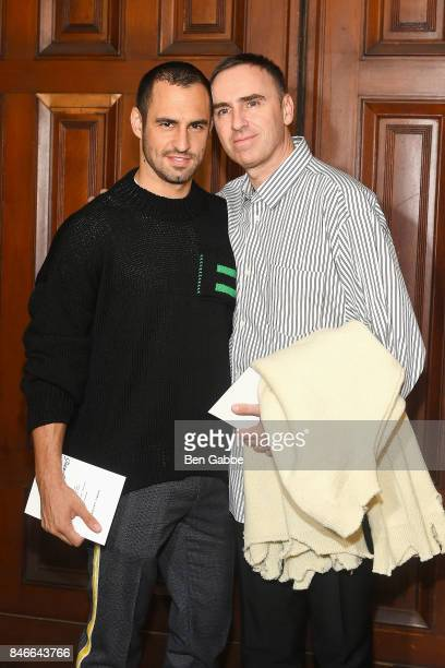 Raf Simons and JeanGeorges d'Orazio attend the Marc Jacobs Fashion Show during New York Fashion Week at Park Avenue Armory on September 13 2017 in...