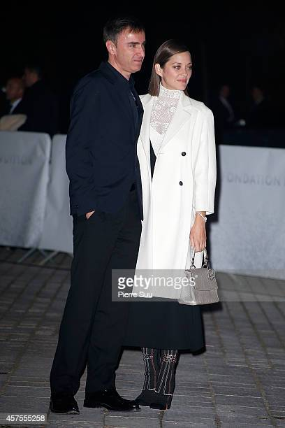 Raf Simons and Marion Cotillard attends the Foundation Louis Vuitton Opening at Foundation Louis Vuitton on October 20, 2014 in Boulogne-Billancourt,...