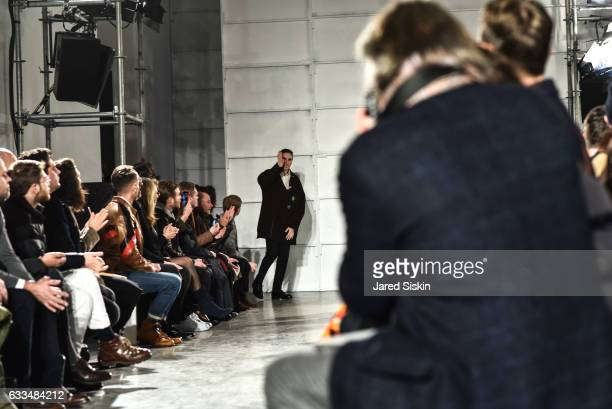 Raf Simons greets the audience at the Raf Simons show during NYFW Men's on February 1 2017 in New York City