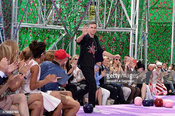 Raf Simons waves to the crowd on the runway during the Christian Dior show as part of Paris Fashion Week Haute Couture Fall/Winter 2015/2016 on July...
