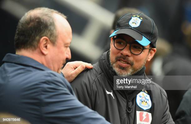 Rafa Benitez Manager of Newcastle United talks with David Wagner Manager of Huddersfield Town during the Premier League match between Newcastle...