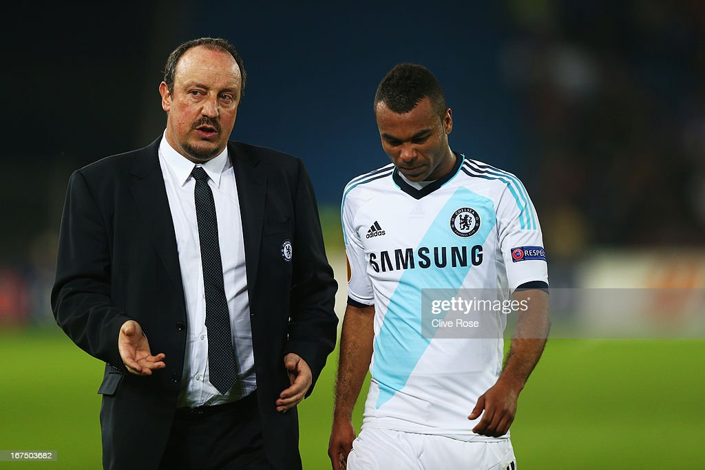 Rafa Benitez the Chelsea interim manager talks to Ashley Cole during the UEFA Europa League Semi Final First Leg match between FC Basel 1893 and Chelsea at St. Jakob Stadium on April 25, 2013 in Basel, Switzerland.