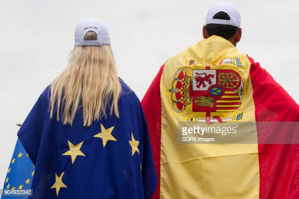 Rafa Cabrera Bello is seen with Spain flag while a lady with a Europe Flag on the last day at EurAsia Cup 2018 EurAsia Cup is a biennial men...