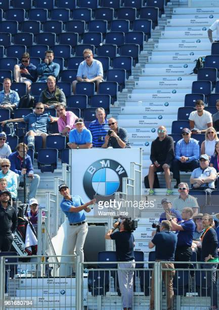 Rafa Cabrera Bello of Spain and Alexander Levy of France take part in a stunt as they play from the grandstand during the BMW PGA Championship Pro Am...
