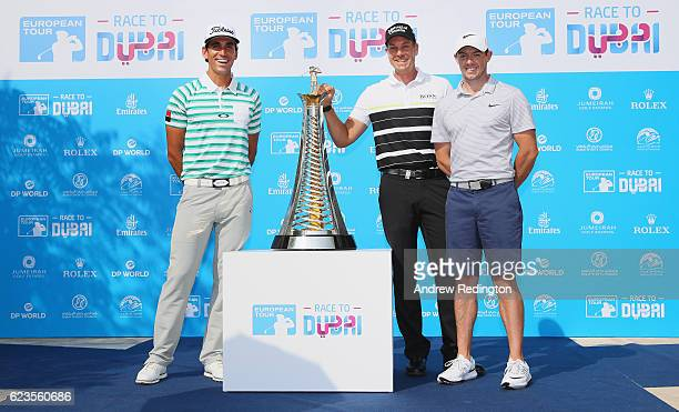 Rafa Cabrera Bello of Spain Henrik Stenson of Sweden and Rory McIlroy of Northern Ireland stand in front of the new Race to Dubai brand featuring the...