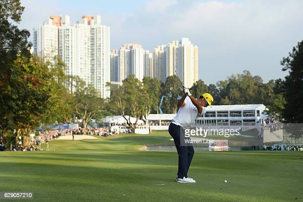 Rafa Cabrera Bello of Spain plays his second shot into the 18th green during the final round of the UBS Hong Kong Open at The Hong Kong Golf Club on...