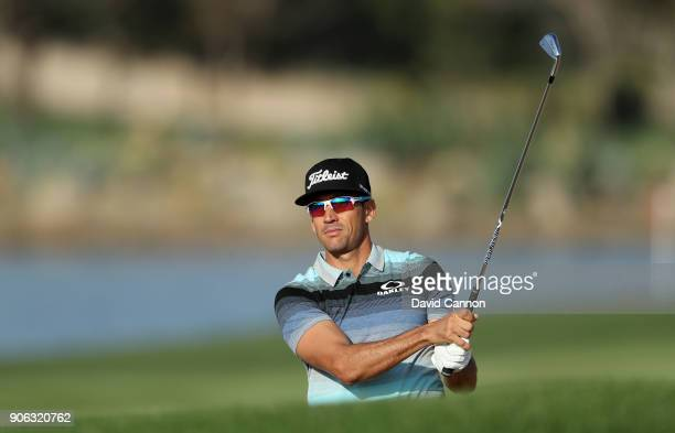Rafa Cabrera Bello of Spain plays his second shot on the par 4 14th hole during the first round of the 2018 Abu Dhabi HSBC Gof Championship at the...