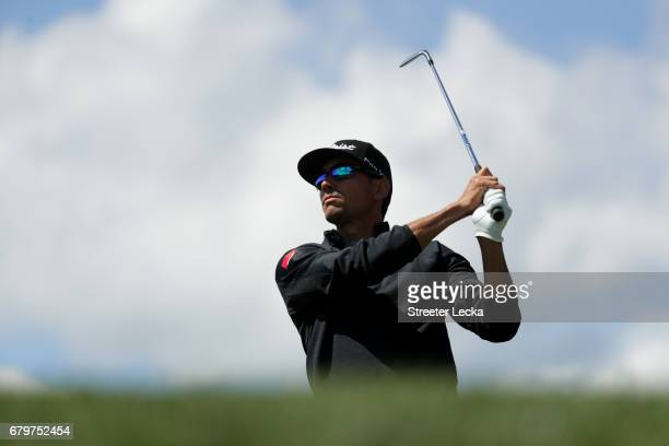 Rafa Cabrera Bello of Spain plays his shot from the tenth tee during round three of the Wells Fargo Championship at Eagle Point Golf Club on May 6...